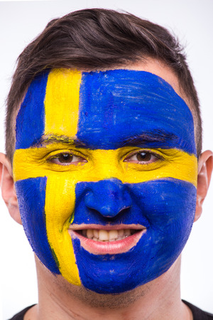 swede: Face portrait of Swede football fan support Sweden national team on white background. European football fans concept. Stock Photo