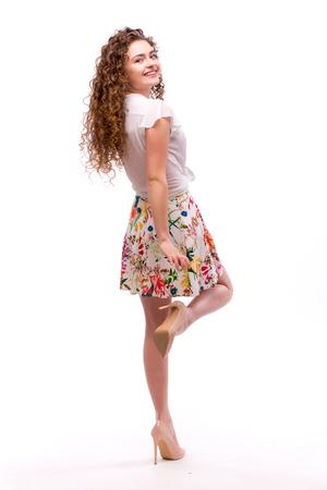 dishevel: Beautiful curly girl posing on white background
