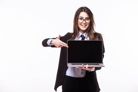 young add: Smiling pretty young woman with friendly happy smile holding a laptop computer and pointing at screen where you add your marketing message