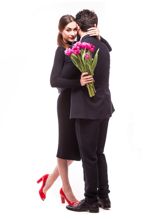lila: Young sweet couple with lila tulips on white background Stock Photo