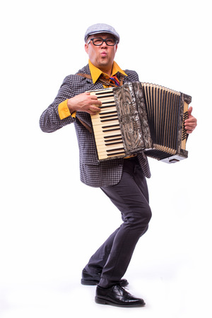 Male singer artist play on accordion on white background