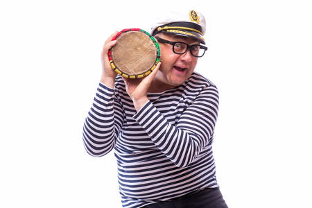 Sailor showman singer with musical instruments drum and accordion on white back Stock Photo