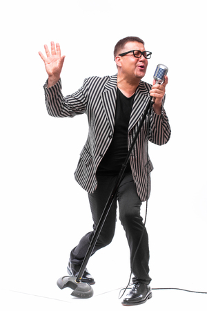 Showman with microphone Stock Photo