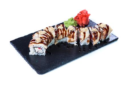 noix saint jacques: Sushi Set and sushi rolls on black stone slate. Restaurant food concept. Banque d'images
