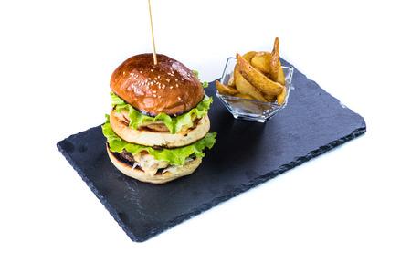 Tasty grilled  burger. Restaurant food concept. Stock Photo
