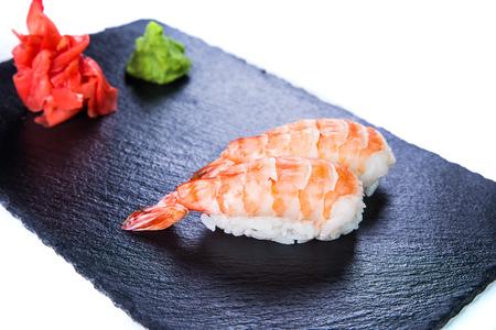 Sushi Set and sushi rolls on black stone slate. Restaurant food concept. Stock Photo