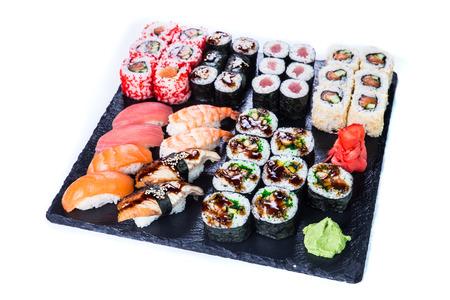 Sushi Set  and sushi rolls on black stone slate. Restaurant food concept.