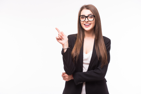 pretty brunette woman: Young elegant business woman pointing invisible product at white background Stock Photo