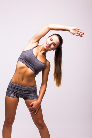 Slim fitness young woman Athlete girl doing plank exercise Stock Photo