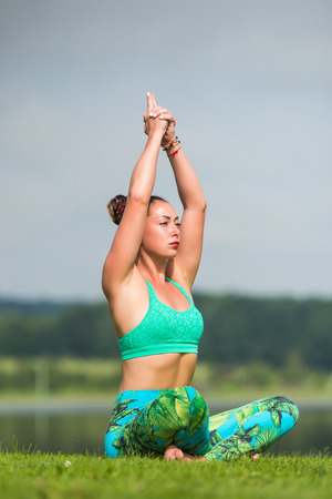 meditation. Yoga girl training outdoors on nature background. Yoga concept. Stock Photo