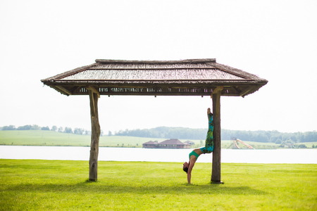 Yoga girl training outdoors on nature background. Yoga concept.