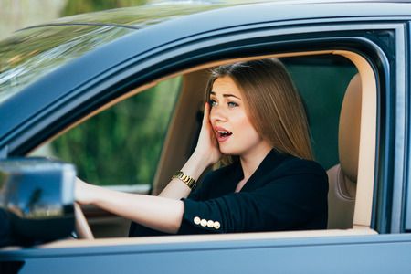 shoked: Girl shoked and scare before accident on road with car. Stock Photo