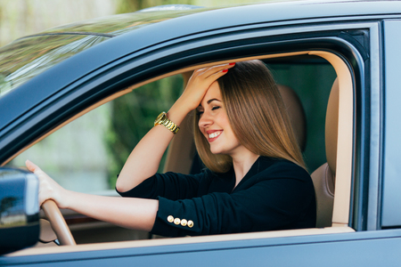 Girl gesture about mistake on road in drive car Stock Photo