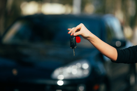 drivers seat: Girl hands with key of new car Stock Photo