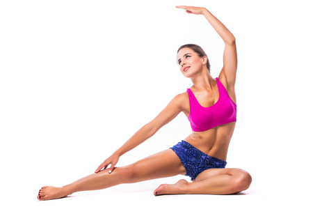 cross legs: Slim fitness young woman Athlete girl doing plank exercise with legs on white background concept training workout crossfit gymnastics cross fit.