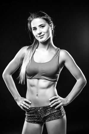 attractive fitness woman, trained female body. Black and white photo. Stock Photo