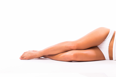 feet naked: Woman laying on the white floor. Copyspace. Stock Photo