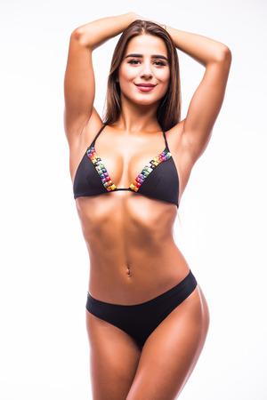 Femme en maillot de bain avec abs parfait, corps en forme