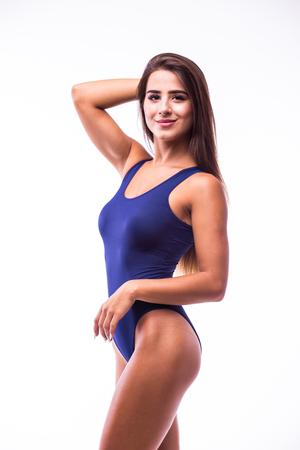 busty: La muchacha atractiva en traje de baño aislado en blanco Foto de archivo