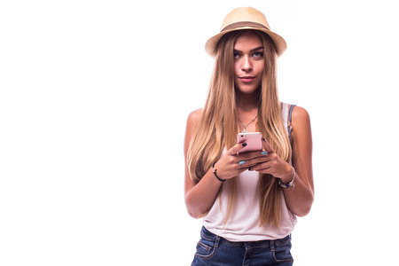 Attractive girl  using her smartphone for texting Stock Photo
