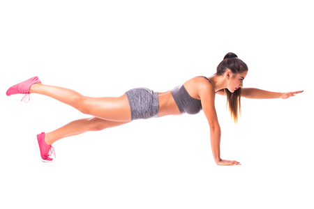 Bird Dog Plank. Young woman doing sport exercise.