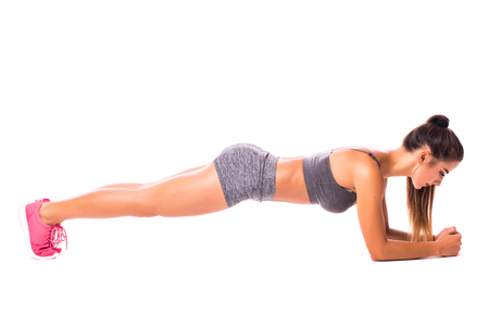 Elbow Plank. Young woman doing sport exercise.