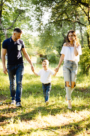 holiday spending: Young family spending holiday in park Stock Photo