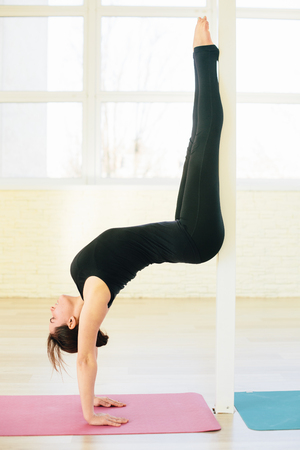 hasta: Beautiful yoga woman practice in a training hall background. Yoga concept. Stock Photo