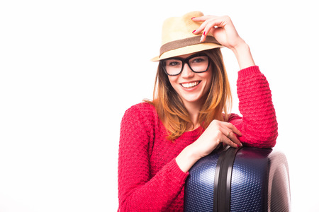 vocation: casual woman standing with travel suitcase - isolated on white background. Vocation concept