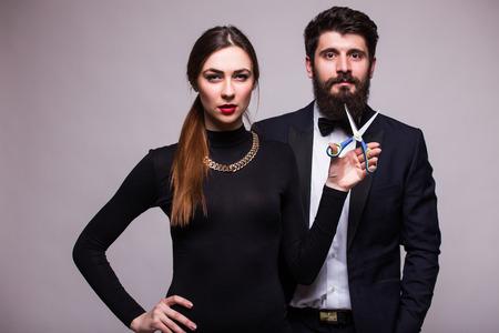 fiestas electronicas: Beauty girl cup boyfriend beard on grey background