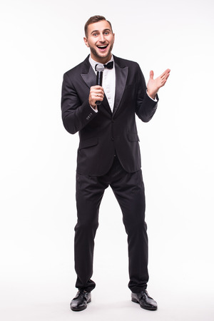 the showman: The Showman interviewer with emotions. Young elegant man holding microphone against white background.Showman concept.