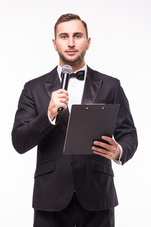the showman: The Showman interviewer with blank. Young elegant man holding microphone against white background.Showman concept.