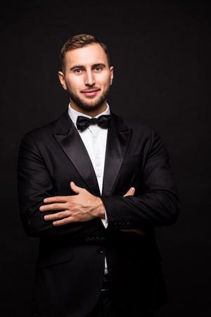 the showman: The showman in suit over black background. Showman concept.