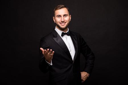 showman: The showman in suit over black background. Showman concept.