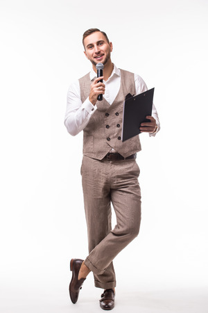 The Showman interviewer with blank. Young elegant man holding microphone against white background.Showman concept.