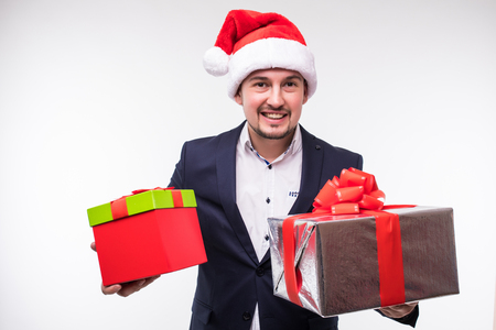 Handsome business man with new year lights and gifts in hands