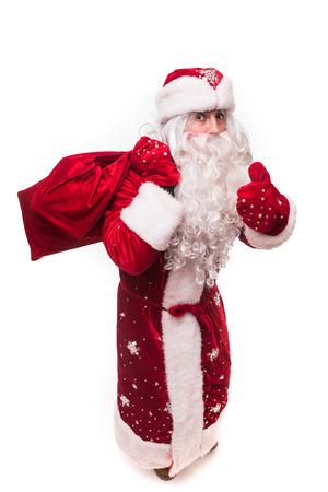 Cheerful man santa claus holding gift sack Stock Photo