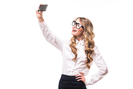 white backgroung: Young business girl with eyeglasses take selfie from phone on white backgroung Stock Photo
