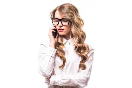 Young business girl with eyeglasses speak on phone on white backgroung Stock Photo