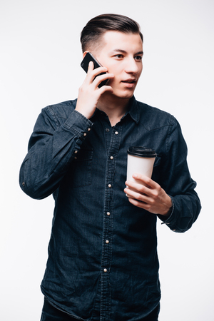 house call: Young man wearing casual clothes talking on a mobile phone