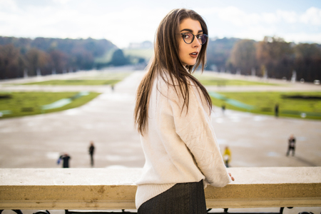 arhitecture: Beautiful young woman on balkon of house  on park background