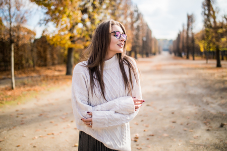Young girl possing  in autumn park Stock Photo