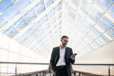 profesional: Boos look in his phone on his panoramic office Stock Photo