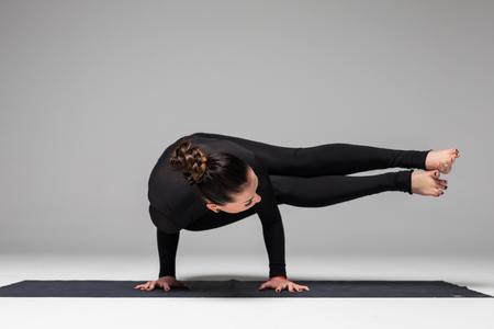 hasta: Beautiful yoga woman practice yoga poses on grey background. Yoga concept.