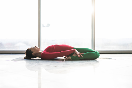 ardha: Beautiful yoga woman practice in a big window hall background. Yoga concept.