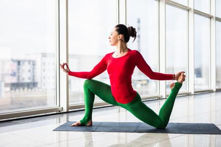 hasta: Beautiful yoga woman practice in a big window hall background. Yoga concept.