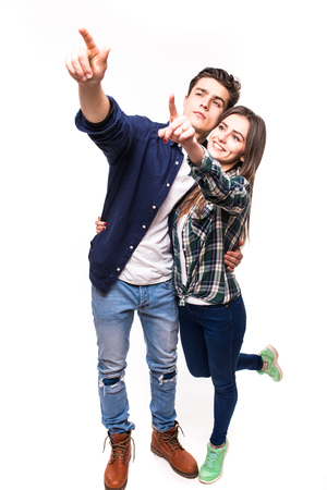 Couple pointed with finger up on white Stock Photo