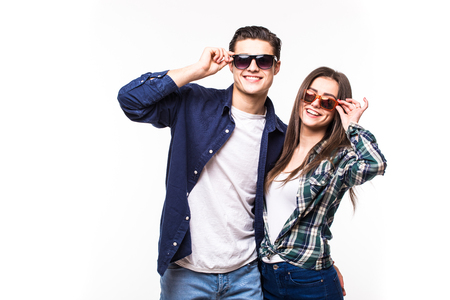 Beauty smile couple in sunglasses on white background