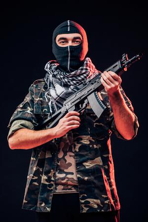 iraq: Terrorist attack. Terrorist with gun on black background