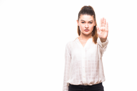 Serious business woman making stop hand sign isolated over white background Stock Photo